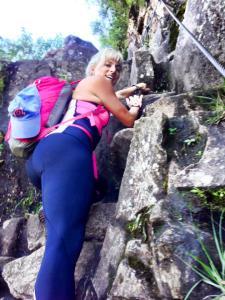 climbing steep wayna picchu stairs